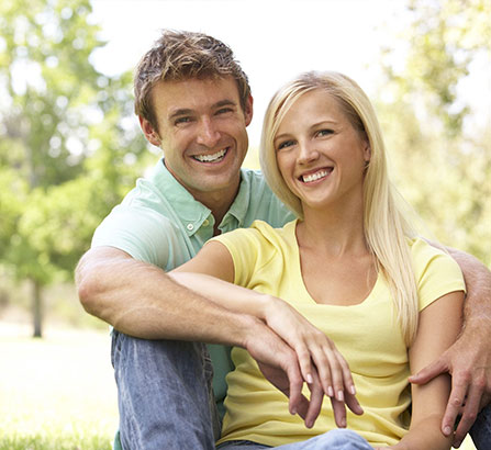 Smiling couple holding hands in a park